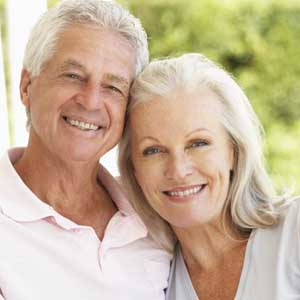 mature couple close and smiling