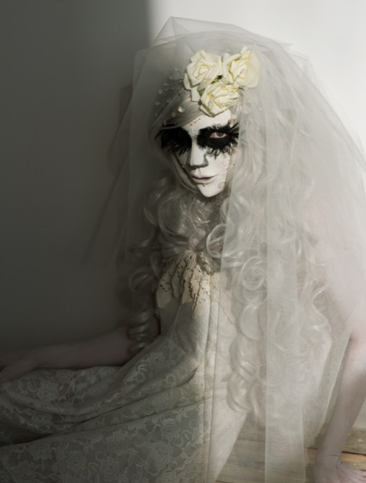 Zombie Bride wearing black eye make-up and colored contacts